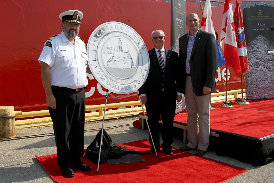 the-new-20-dollar-fine-silver-coin-proudly-presented-by-mp-jeff-watson-the-assistant-commissioner-wade-spurrell-and-the-chairman-of-the-royal-canadian-mint-jim-love