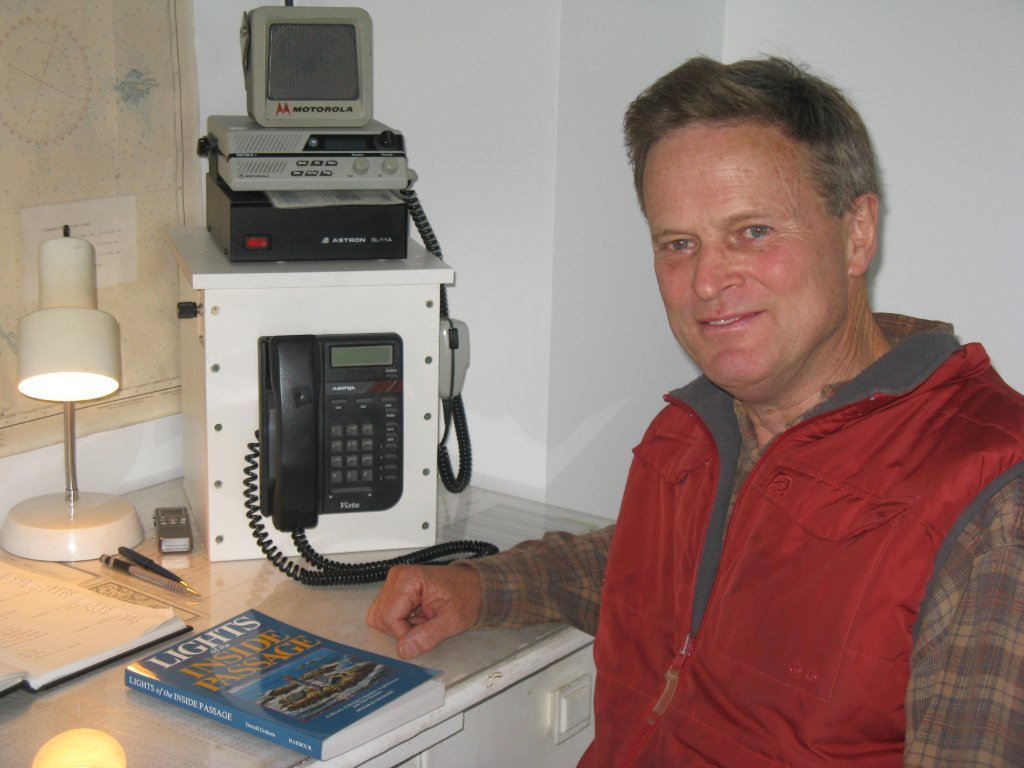 Dave Pearce with radio equipment in background